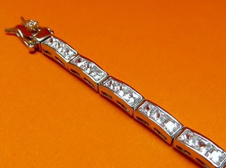 """Picture of """"Classic Channels of Zirconia"""" tennis bracelet in sterling silver and channels of square cubic zirconia"""
