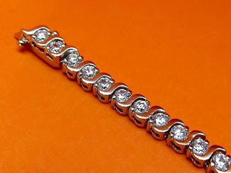 "Picture of ""Dashing Zirconia"" tennis bracelet in sterling silver and round cubic zirconia with wave dashes"