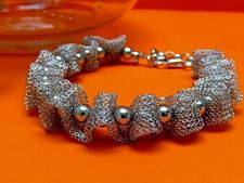 "Picture of ""Fancy Net"" bracelet entirely in sterling silver, mesh interspersed with polished round beads"
