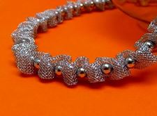 "Picture of ""Fancy Net"" necklace entirely in sterling silver, mesh interspersed with polished round beads"
