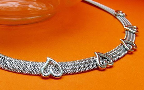 "Picture of ""Herringbone heart"" necklace entirely in Italian sterling silver, flat herringbone decorated with polished hearts"