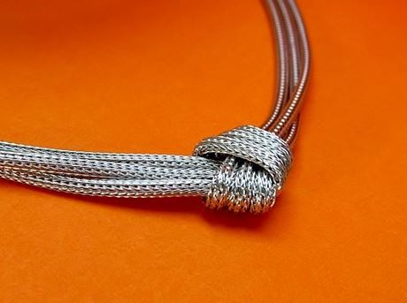 "Picture of ""Mesh Love Knot"" necklace entirely in Italian sterling silver, triple mesh with love knot"