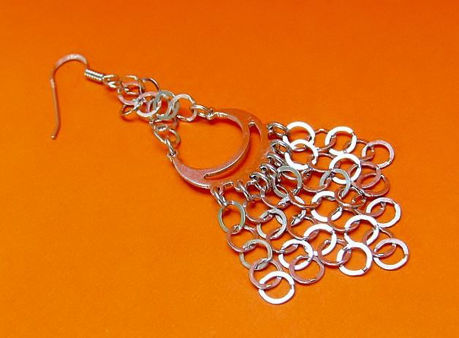 "Picture of ""Moon"" diamond cut basket earrings entirely in polished sterling silver with little chains of flat rings"
