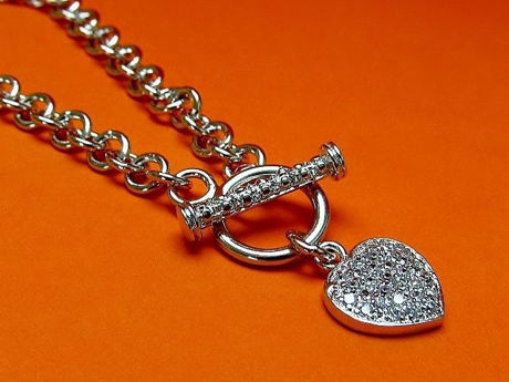 "Picture of ""Pavé heart"" bracelet in sterling silver, rolo link chain with heart charm and toggle bar inlaid with cubic zirconia"