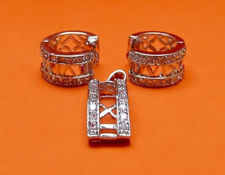 "Picture of ""Roman numerals"" set of pendant and hinged huggies in sterling silver with a row of Roman numerals framed by round cubic zirconia"