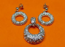 """Picture of """"Textured"""" set of pendant and dangle earrings in sterling silver, a textured circle inlaid with round cubic zirconia"""