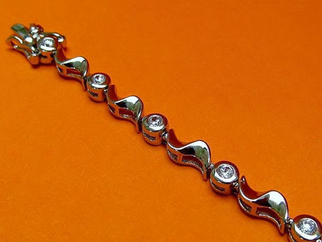 "Picture of ""Waves of Zirconia"" tennis bracelet in sterling silver, round cubic zirconia interspersed with silver waves"