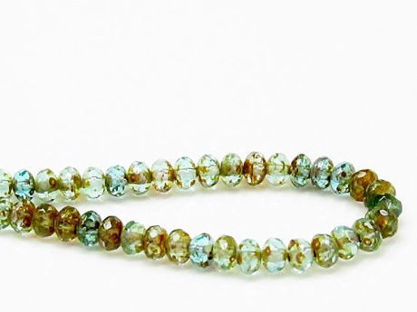 Picture of 3x5 mm, Czech faceted rondelle beads, turquoise blue, transparent, picasso