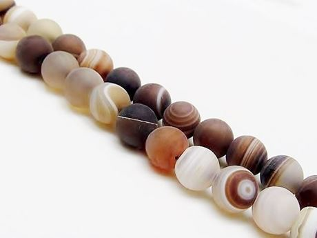 Picture of 8x8 mm, round, gemstone beads, natural striped agate, caramel to deep brown, frosted
