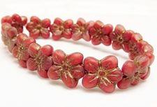 Image de 14x13 mm, perles de verre tchèque pressé, fleur de cerisier, rouge naphtol, mat, patine dorée à l'ancienne