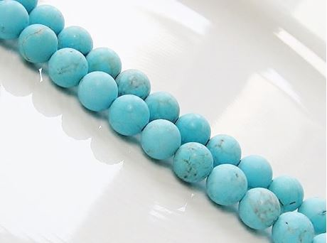Picture of 8x8 mm, round, gemstone beads, magnesite, turquoise blue, frosted