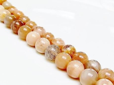 Picture of 8x8 mm, round, gemstone beads, sunstone, peachy yellow, natural, B-grade