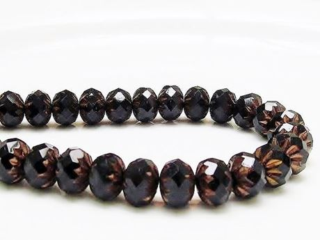 Picture of 7x10 mm, carved cruller beads, Czech, black, opaque, rusty bronze sides