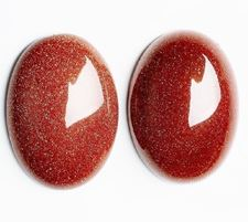 Picture of 10x14 mm, oval, gemstone cabochons, goldstone, red