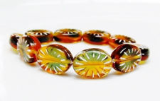 Picture of 5x14x11 mm, Czech druk beads, puffy oval, variegated amber brown and ocean blue, transparent, white comma dashes