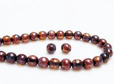 Picture of 6x6 mm, round, Czech druk beads, amber brown, transparent, picasso