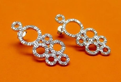 "Picture of ""Zirconia bubbles"" earrings in sterling silver, a cluster of seven circles encrusted with round cubic zirconia"
