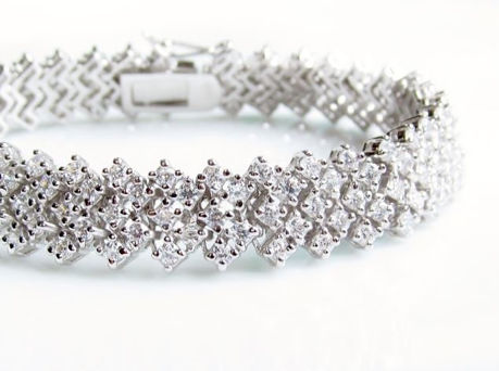 """Picture of """"Zirconia in rhombus setting"""" bracelet in sterling silver, a wave of  round cubic zirconia in rhombus pattern"""