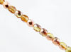 Picture of 3x3 mm, Czech faceted round beads, light topaz yellow, transparent, half tone rose gold mirror