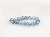 Picture of 4x4 mm, Czech faceted round beads, transparent, light Montana blue luster