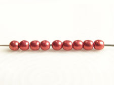 Picture of 2x2 mm, round, Czech druk beads, samba red, opaque, sueded gold