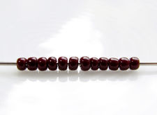 Picture of Japanese seed beads, Toho, size 11/0, oxblood or deep red, opaque